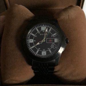 Men's G-Timeless Gucci watch.
